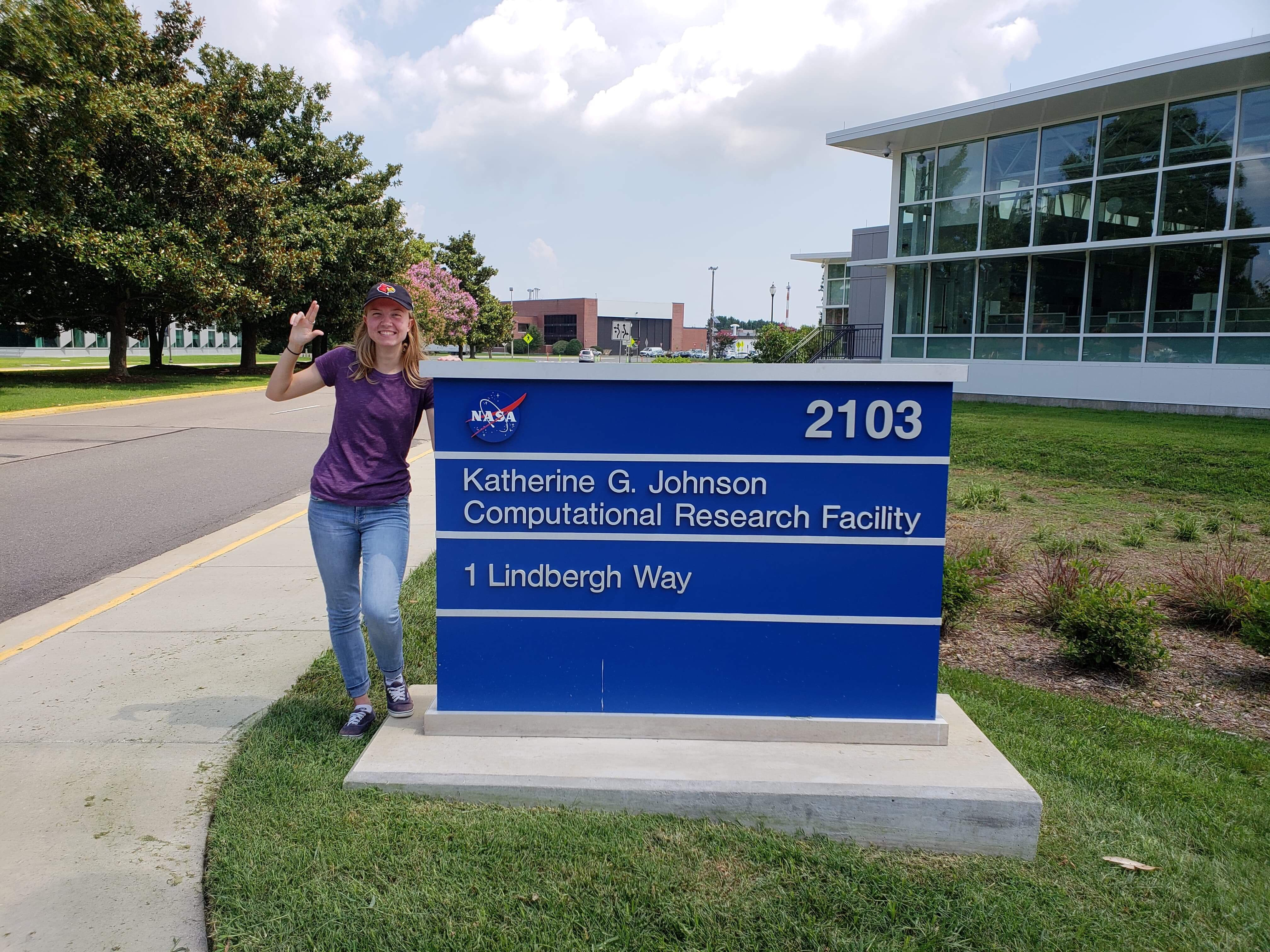 Meghan Carricon in front of NASA's 'Katherine G. Johnson Computational Research Facility